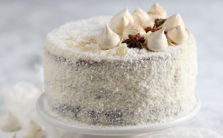 Tούρτα με καρύδα: Εύκολη συνταγή για το απόλυτο Χριστουγεννιάτικο γλυκό